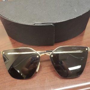 Prada Cinema Polarized Sunglasses.